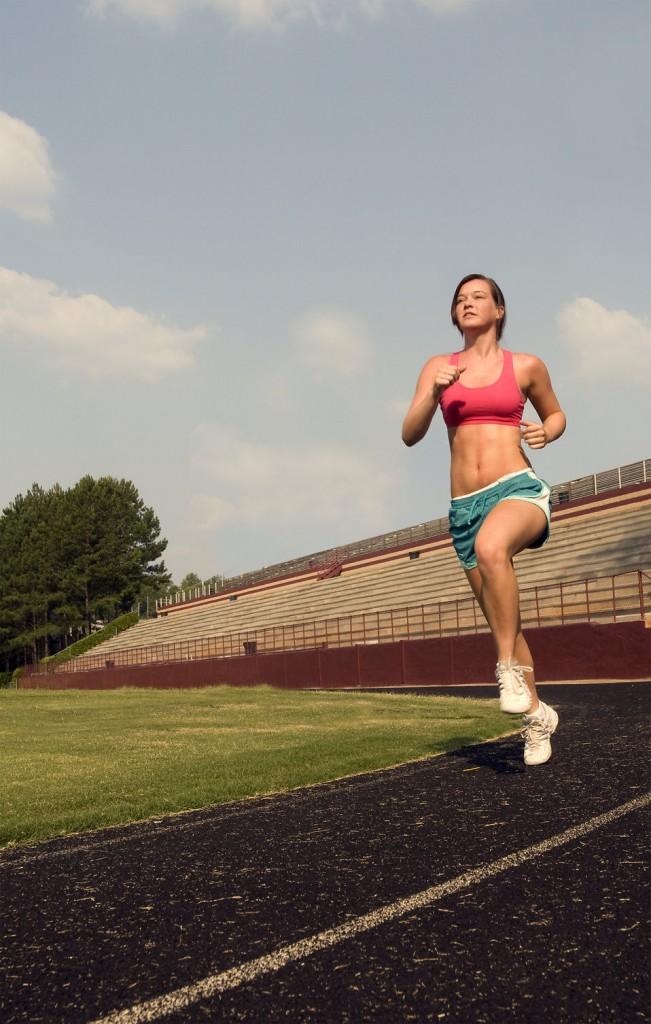 15317-a-healthy-young-woman-running-outdoors-on-a-track-pv